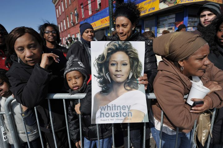 People gather outside New Hope Baptist Church during a private funeral for singer Whitney Houston on Feb. 18, 2012, in Newark