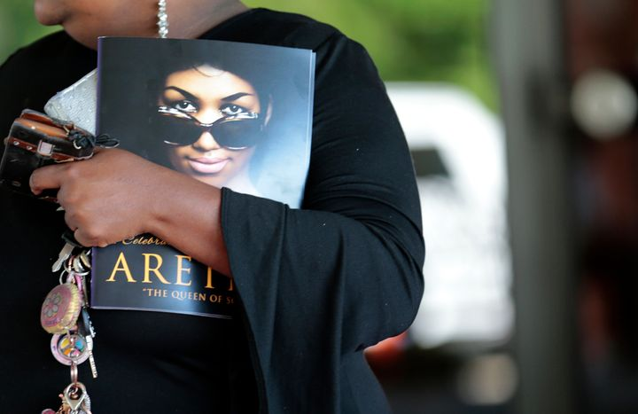 A mourner holds a program from Aretha Franklin's funeral at Detroit's Greater Grace Temple on Aug. 31, 2018.