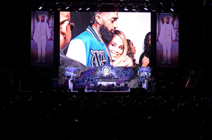 """Photos are displayed during Nipsey Hussle's """"Celebration of Life"""" on April 11, 2019, at Staples Center in Los Angeles. Nipsey"""