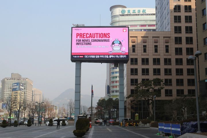 A huge electric screen broadcasts precautions against the COVID-19 outbreak in Seoul on Feb. 20.