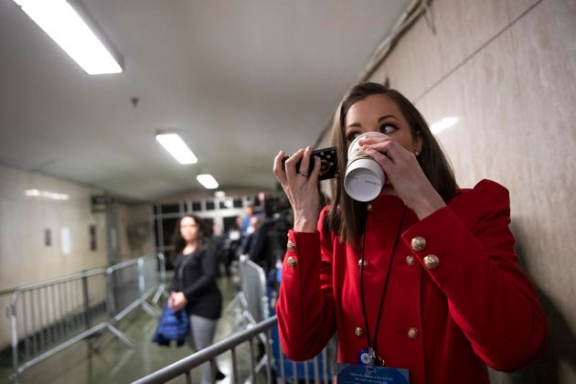 Court TV legal correspondent Chanley Painter drinks coffee and talks on the phone while waiting for Harvey...