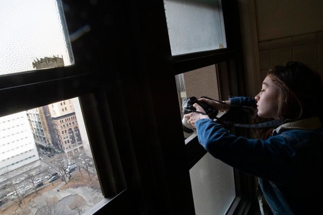 New York Times photographer Brittainy Newman tests the light while waiting to shoot Harvey Weinstein...