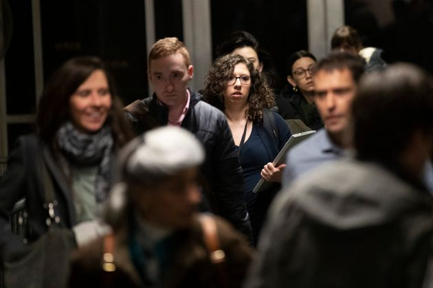 Washington Post reporter Shayna Jacobs, center, leaves the courtroom at the end of the day in Harvey...