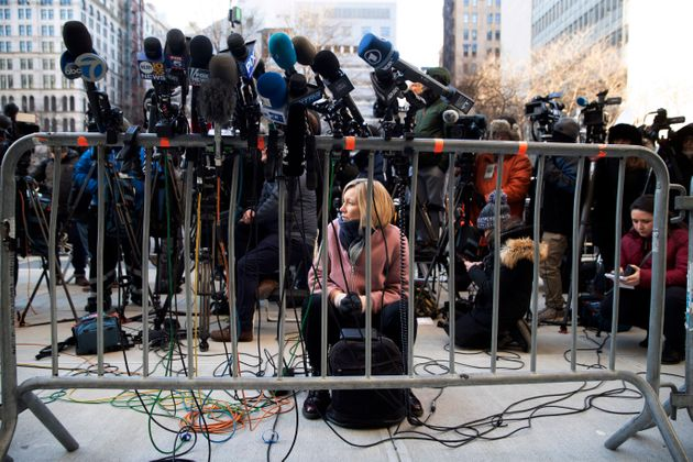 Rebecca Barry of ITV New waits for lawyers to come address the media after Harvey Weinstein left court...