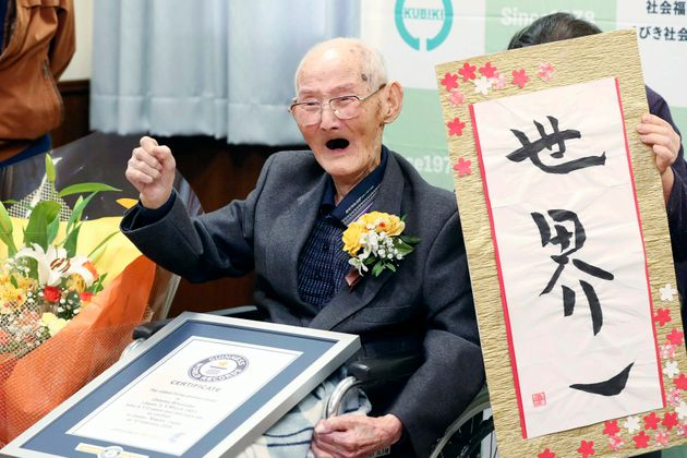 In this Feb. 12, 2020 file photo, Chitetsu Watanabe, 112, poses next to the calligraphy he wrote after...
