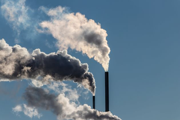 Factory stacks release emissions into the