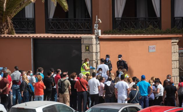 A psychologist talks to a group of workers outside the H10 Costa Adeje Palace Hotel in La Caleta, on...