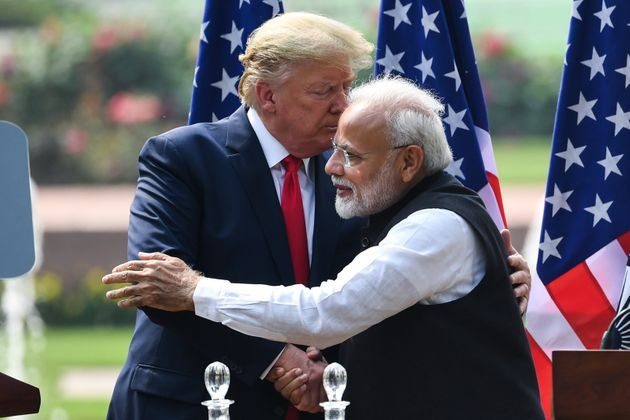 US President Donald Trump shakes hands with Prime Minister Narendra Modi during a joint press conference...