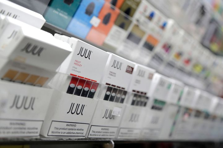 Juul products are displayed at a smoke shop in New York. The popular e-cigarette company has faced a number of lawsuits over