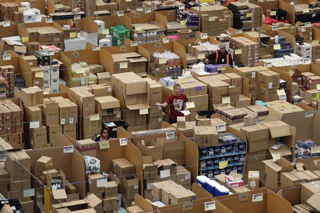 Parcels are processed and prepared for dispatch at Amazon's fulfillment center in Peterborough,