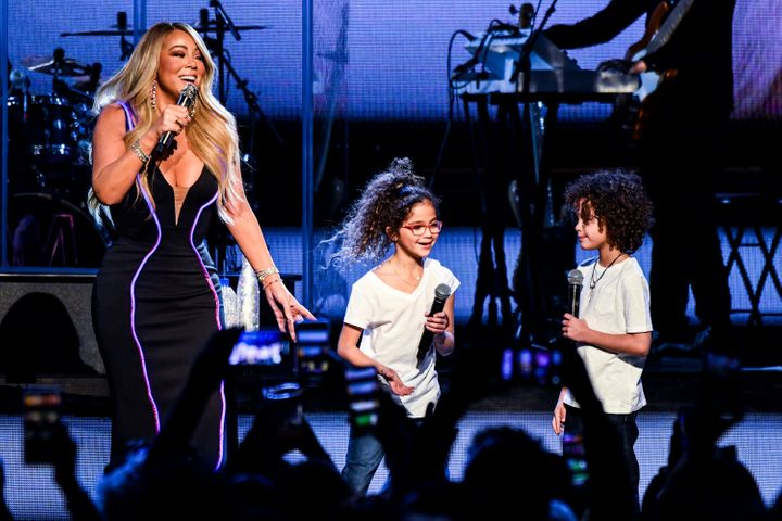 Mariah Carey performs with her kids Monroe Cannon and Moroccan Cannon during the the Caution World Tour in Atlanta, Georgia,