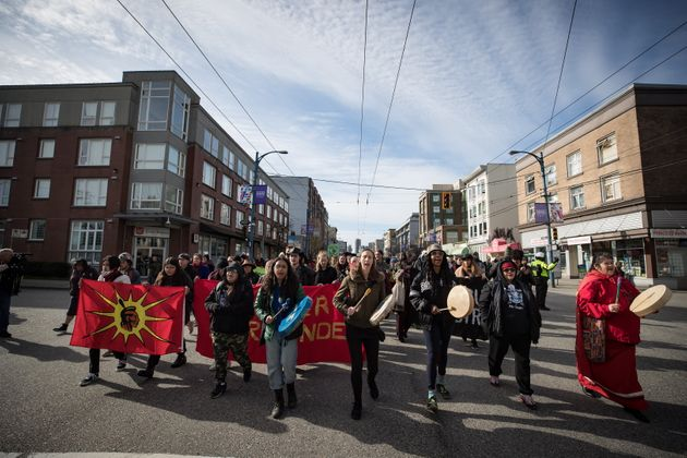 Protesters march to block a road used to access to the Port of Vancouver on Feb. 24,