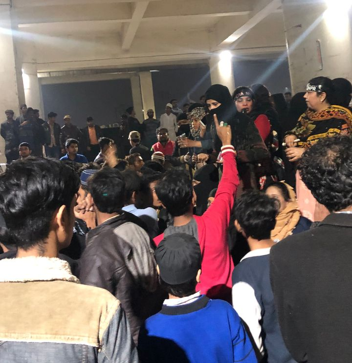 Male supporters surrounding some of the women activists who were in disagreement about withdrawing the sit-in protest from the Jafrabad metro station venue.