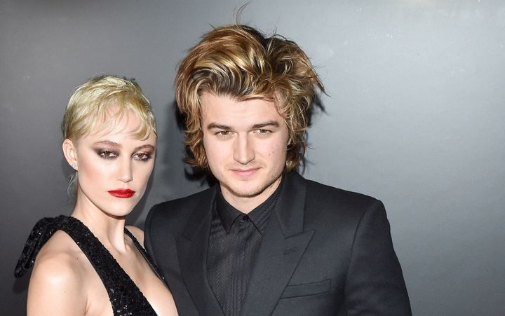 Maika Monroe and Joe Keery attend the Saint Laurent show at Paris Fashion Week.