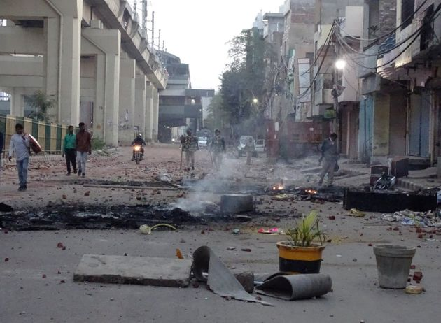 A vandalized street following violence in north east