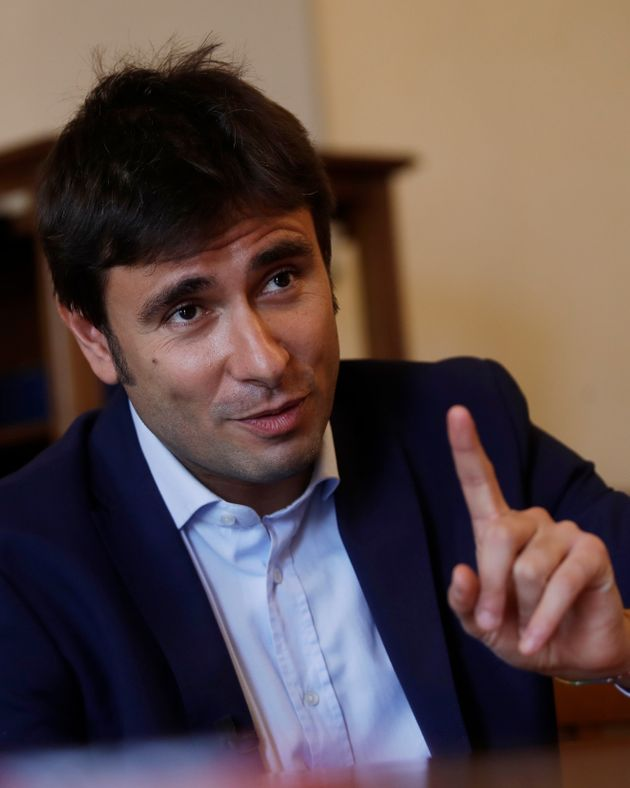 Italy's 5-Star Movement lawmaker Alessandro Di Battista answers questions during an interview with the...