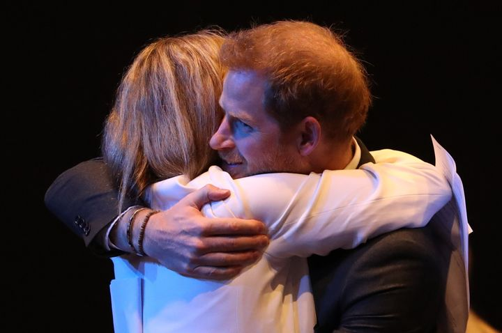 The Duke of Sussex receives a hug as he greets guests at a sustainable tourism summi on Feb. 26, 2020 in Edinburgh, Scotland.