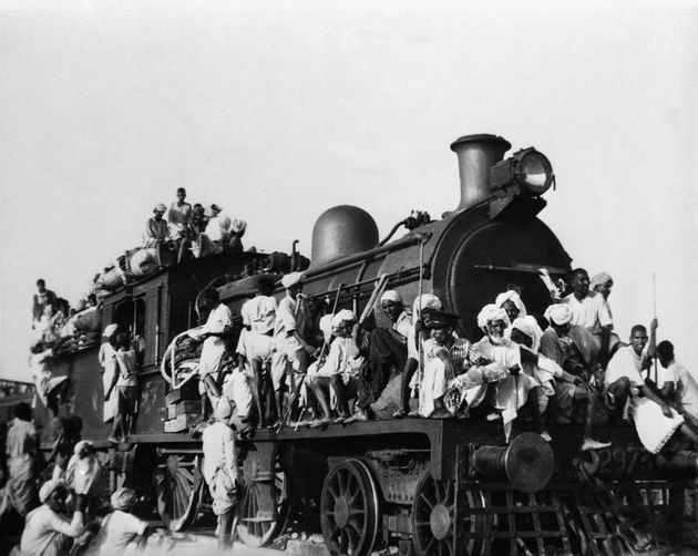 Hundreds of Muslim refugees jam inside and atop the engine and coaches of this train leaving the New...