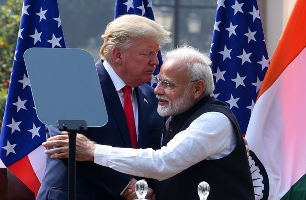 US President Donald Trump and Prime Minister Narendra Modi greet each other after their joint statement,...