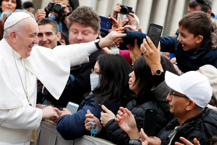 Pope Francis greets Catholic pilgrims during his weekly general audience at the Vatican on Feb. 26, 2020.