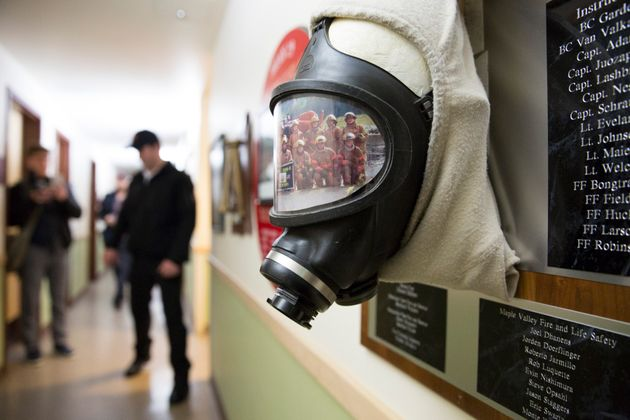 A self-contained breathing apparatus and a photo of recruits is pictured on a plaque inside a Washington...