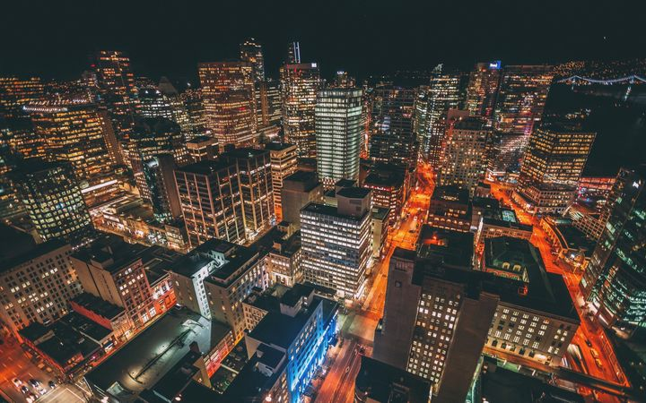 A nighttime aerial view of downtown Vancouver is seen in this stock photo.