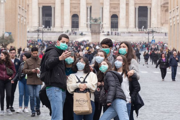 People wear face masks to protect themselves while visiting the Vatican on Ash