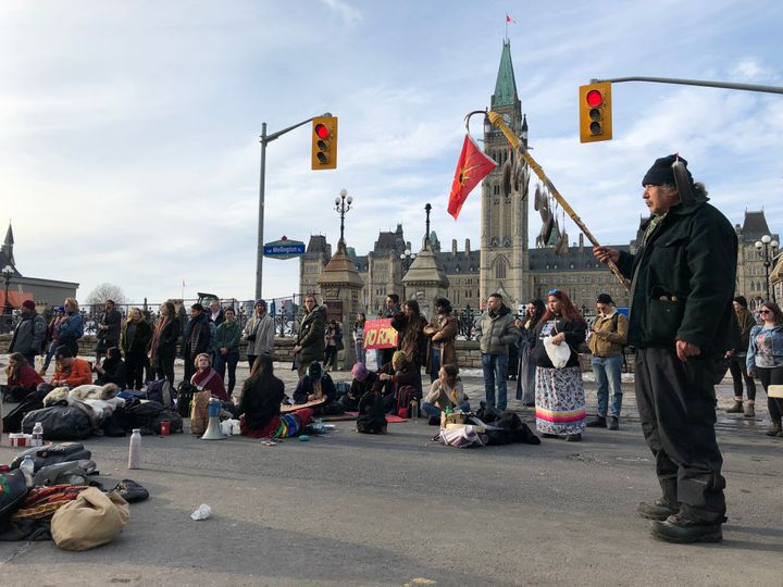 Protesters gather in the streets of Ottawa on Feb. 24, 2020 in support of a small group fighting construction of a natural gas pipeline on indigenous lands in British Columbia.