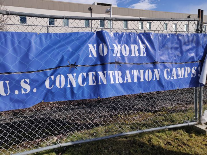 A sign outside the Northwest Detention Center in Tacoma, Washington, bluntly summarized the message of Sunday's demonstration