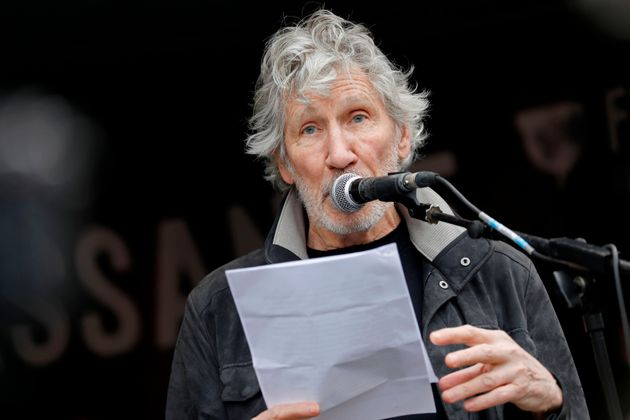 Pink Floyd's Roger Waters speaks after a march in support of Wikileaks founder Julian Assange in London...
