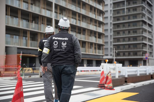 Construction site workers seen inspecting the Tokyo 2020 Olympic/Paralympic Village in