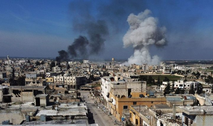 Smoke billows over the town of Saraqib in the eastern part of the Idlib province in northwestern Syria, following bombardment