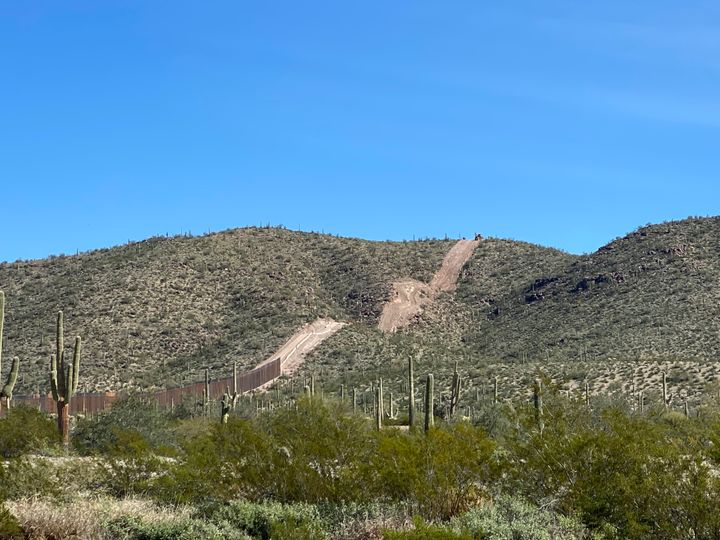 A strip of land prepared for a border wall is seen along Monument Hill in Organ Pipe Cactus National Monument.