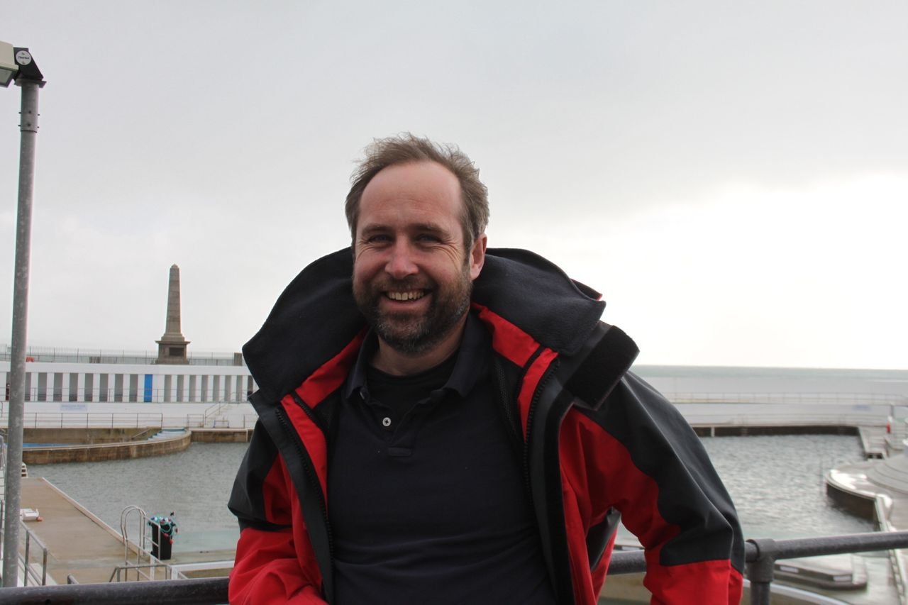 Jon Matthews of the Penzance & District Tourism Association, with the town's seawater swimming pool behind him.