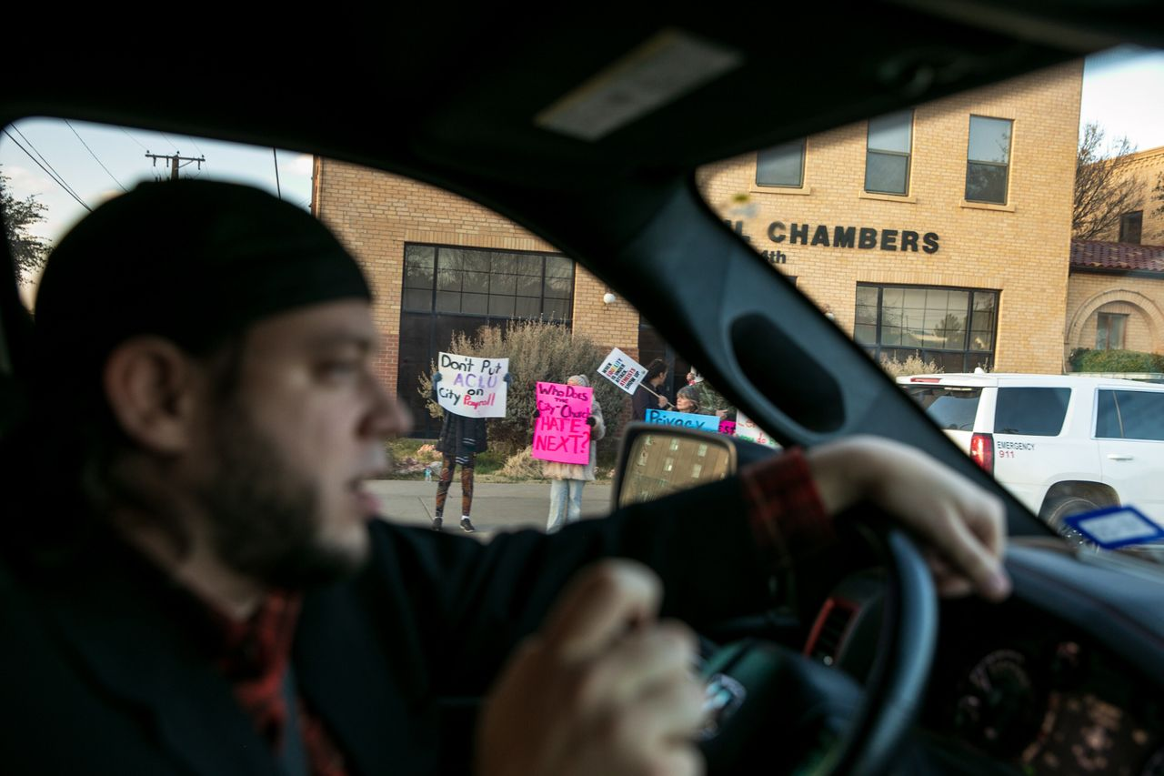Mark Lee Dickson drives by a group of people protesting the proposed abortion ban.