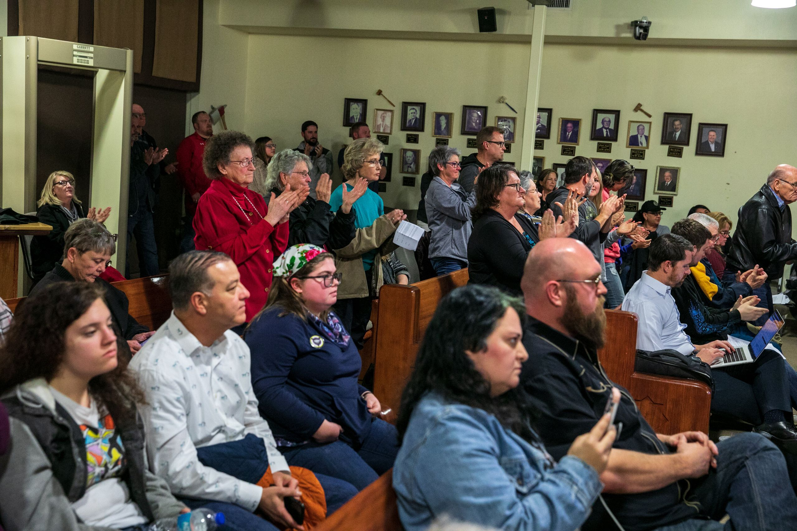 People react as the city ordinance passes, prohibiting abortion procedures within city limits.