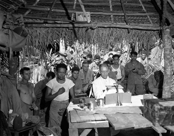 FILE - This Nov. 1, 1944 file photo shows the first religious service on Guam after U.S. landings are attended by soldiers, N