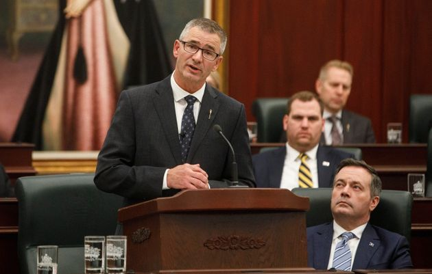Finance Minister Travis Toews delivers the budget as Alberta Premier Jason Kenney watches on Thursday,...