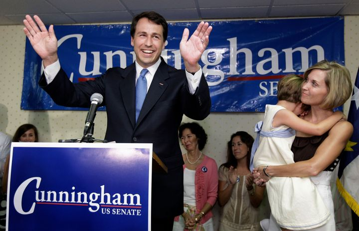Democratic U.S. Senate candidate Cal Cunningham, left, acknowledges supporters as his wife Elizabeth, right, with their daugh