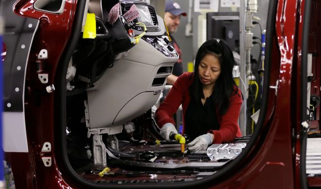 In this May 6, 2016, file photo, an employee works on an assembly line at the Windsor Assembly Plant,...