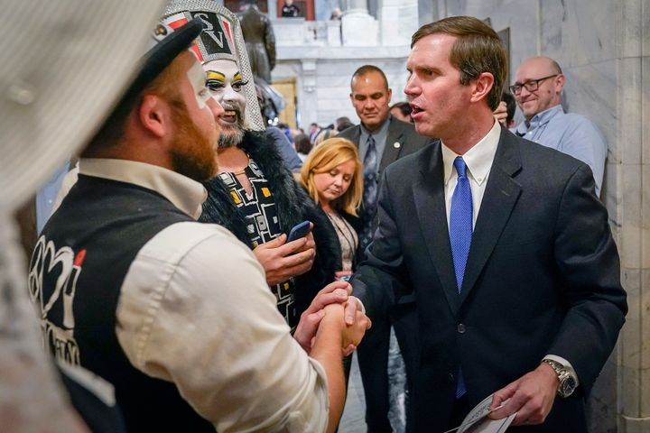 Kentucky Gov. Andy Beshear greets members of the Kentucky Order of the Sisters of Perpetual Indulgence, an LGBTQ charity grou