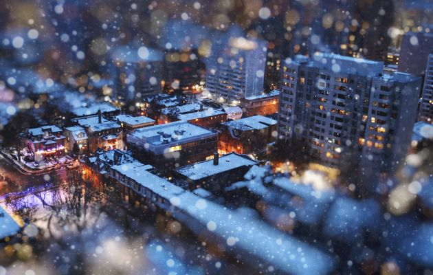 In this stock photo, an aerial view of houses and apartments in Toronto can be seen through a tilt-shift...