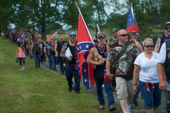 Activists holding Confederate flags gather at the Gettysburg National Military Park on July 1, 2017, in Gettysburg, Pennsylvania. The U.S. park service issued protest permits for three groups, including Sons of Confederate Veterans, on the 154th anniversary of the battle.