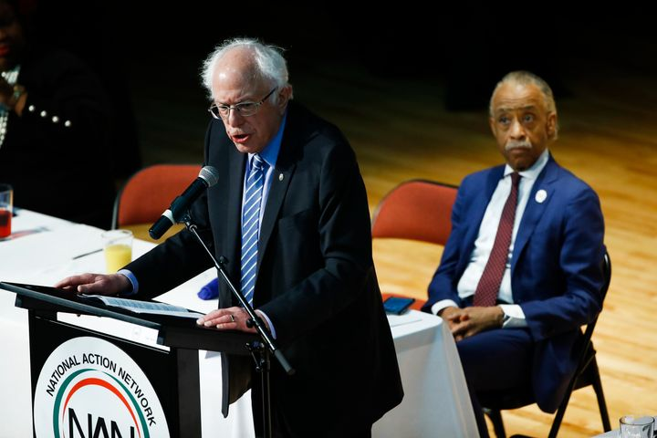The Rev. Al Sharpton listens to Democratic candidate Bernie Sanders at the National Action Network South Carolina Ministers'