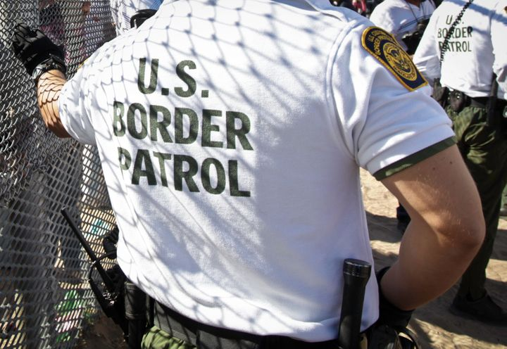 A U.S. Border Patrol agent at the border wall between Juárez, Mexico, and Sunland Park, New Mexico.