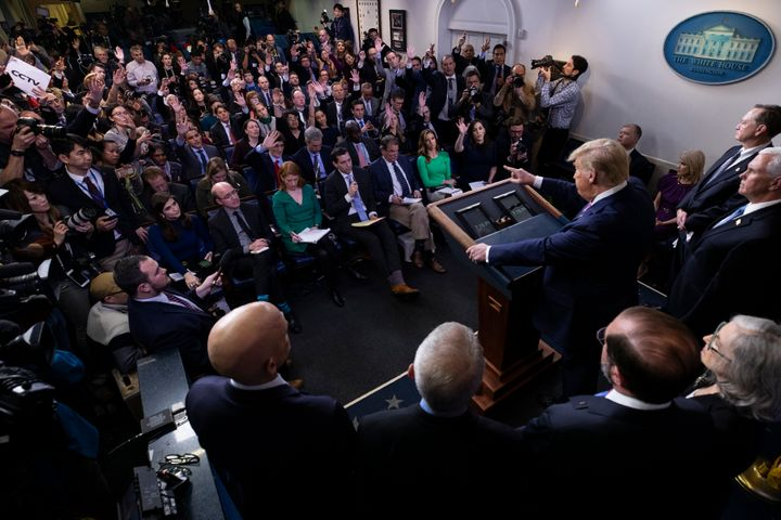 President Donald Trump, with members of the president's coronavirus task force, speaks during a news conference in the Brady