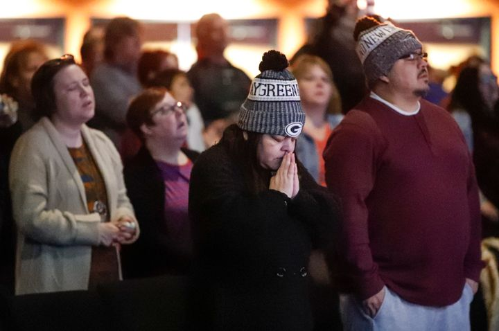 People attend a prayer vigil for victims of the Molson Coors brewery shooting at the Ridge Community Church on Feb. 27, 2020,