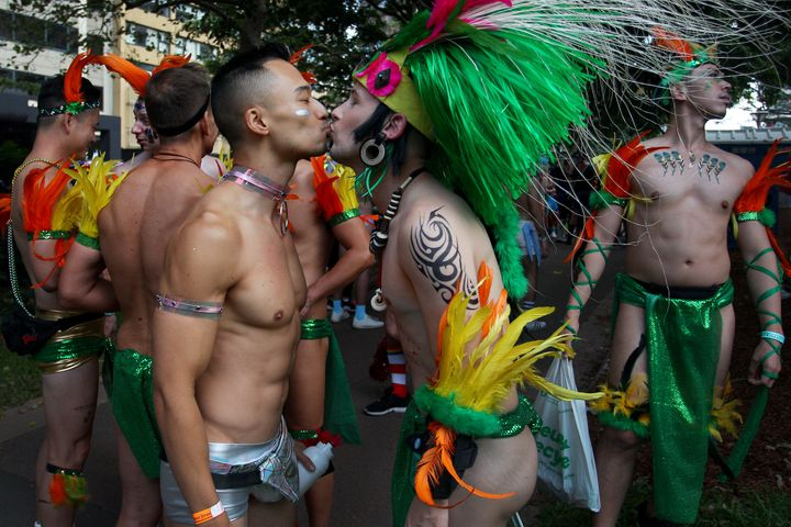 Parade goers kiss during the 2020 Sydney Gay & Lesbian Mardi Gras Parade on February 29, 2020 in Sydney, Australia.