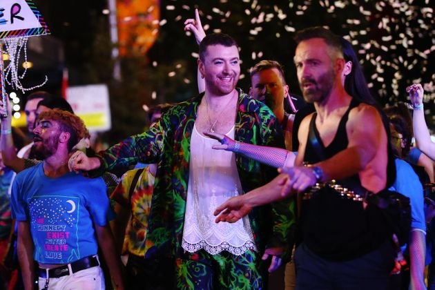 Sam Smith celebrates during the 2020 Sydney Gay & Lesbian Mardi Gras Parade on February 29, 2020...