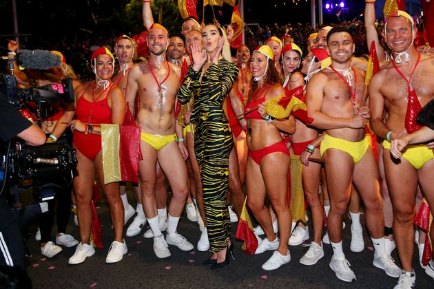 Dua Lipa poses amongst life guards during the 2020 Sydney Gay & Lesbian Mardi Gras Parade on February...